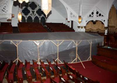 Tent inside Pilgrim Church before roof was repaired