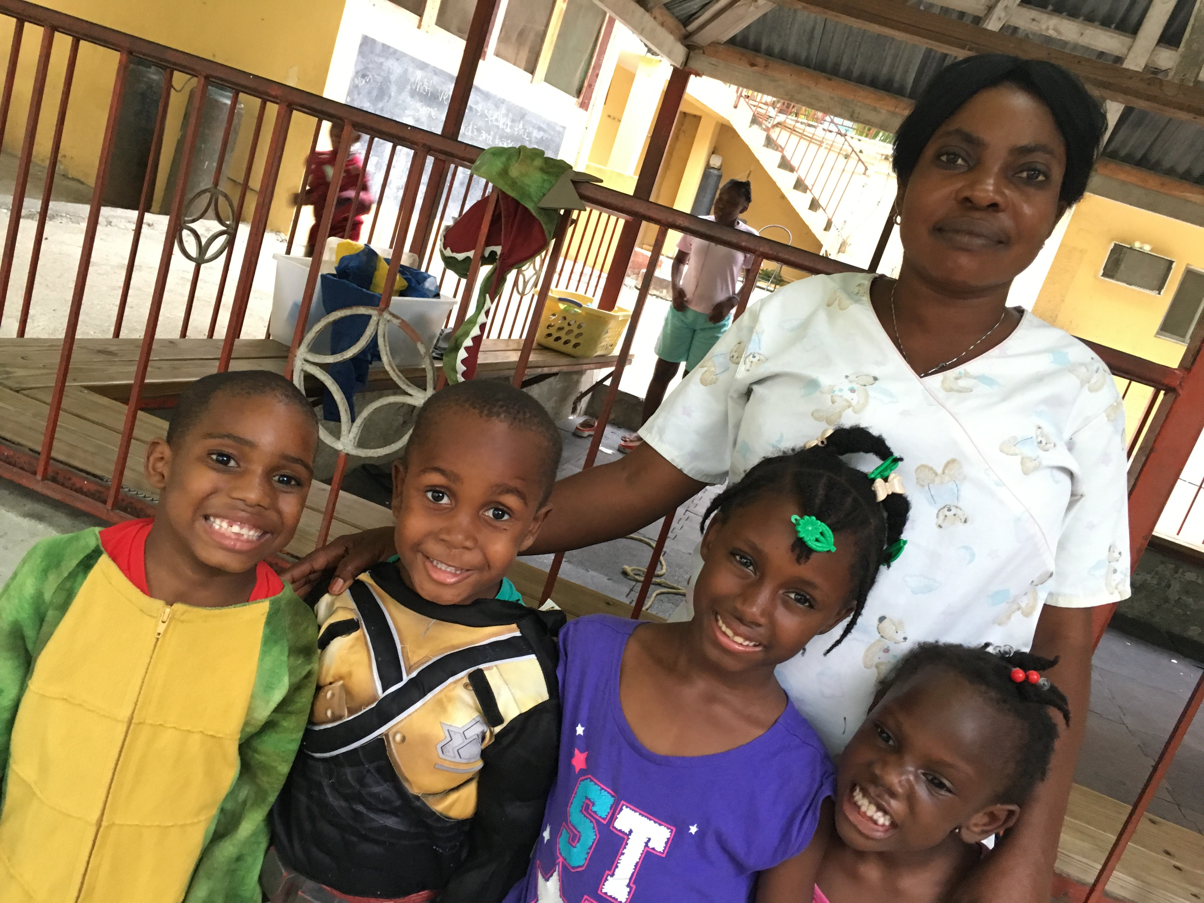 Michou Tousaint, 28, a nanny at the Have Faith Haiti Mission, with some of the children there. She says her entire farming family outside of Jeremie lost their homes and crops and is now sleeping outside, including a 2 month old baby wrapped in coconut leaves.